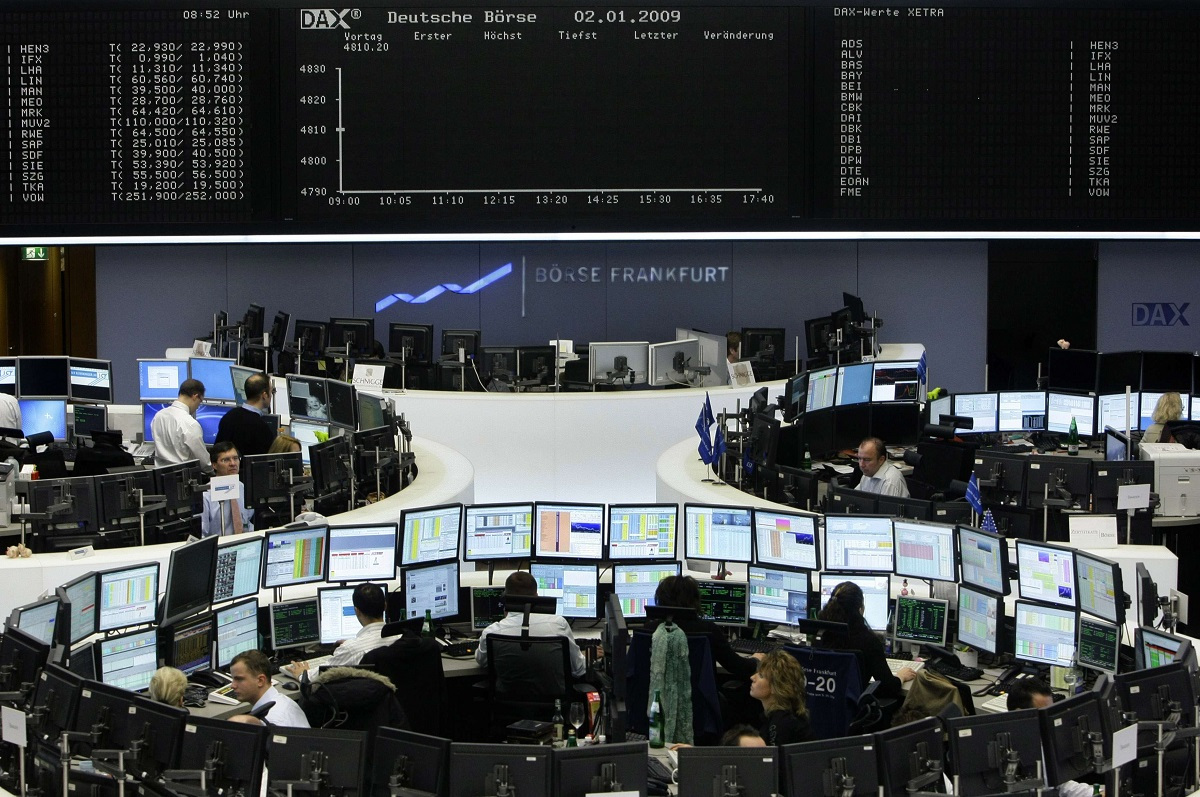 Traders prepare for first notation at beginning of first trading day in 2009 in front of DAX board at Frankfurt stock exchange